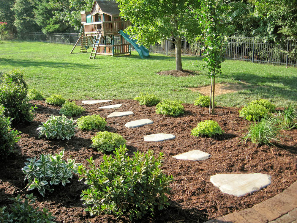 Patio Planting With Natural Stone Path